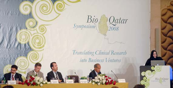 From left to right: Dr Javaid Sheikh, Dr Eulian Roberts, Dr Abdelali Haoudi, Dr Tidu Maini, and H E Dr Ghalia Al Thani speaking at the podium.